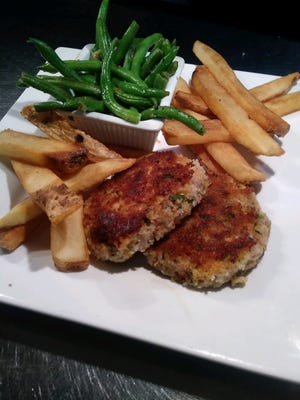Fish cakes and chips are among the traditional British dishes available at Archie's in Melbourne.