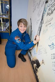 At the Baikonur Cosmodrome Museum in Kazakhstan, Expedition 58 crew member Anne McClain of NASA signed a wall mural on Nov. 29 as part of traditional pre-launch activities. McClain, David Saint-Jacques of the Canadian Space Agency and Oleg Kononenko of Roscosmos will launch Dec. 3 in the Soyuz MS-11 spacecraft from Baikonur for a six-and-a-half month mission on the International Space Station.