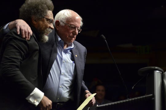 "Sen. Bernie Sanders, I-Vt., left, takes the stage after being introduced by Harvard University professor and activist Cornel West to give the keynote address at The Sanders Institute Gathering Thursday, Nov. 29, 2018, in Burlington. The Gathering is billed as a meeting of  ""250 leading progressive minds to envision – and to actualize – a better future for our country and the world,' organized by the institute co-founded by Sanders' wife, Jane O'Meara Sanders."