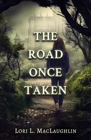 "Vermont author Lori MacLaughlin's new book is ""The Road Once Taken."""