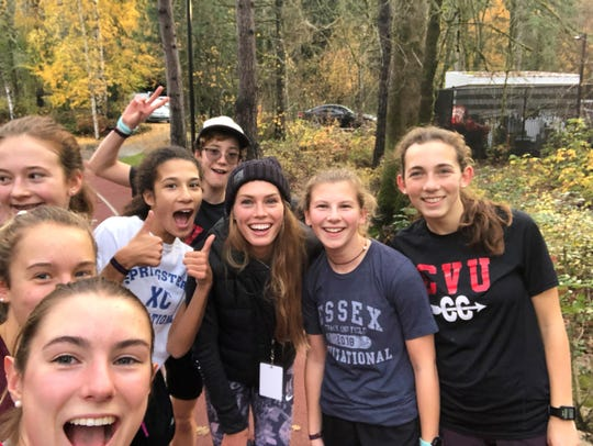 The CVU girls team poses with Nike runner Colleen Quigley in Oregon, two days before the high school standouts compete in the Nike Cross Nationals.