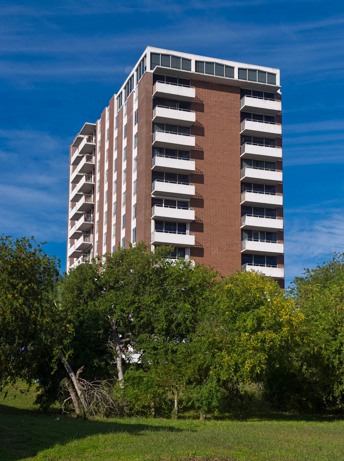 Perched atop a lush hillside overlooking Corpus Christi Bay, the architectural award winning Cliff House, constructed  in 1965 offers some of the best panoramic views of the waterfront and Downtown Marina.