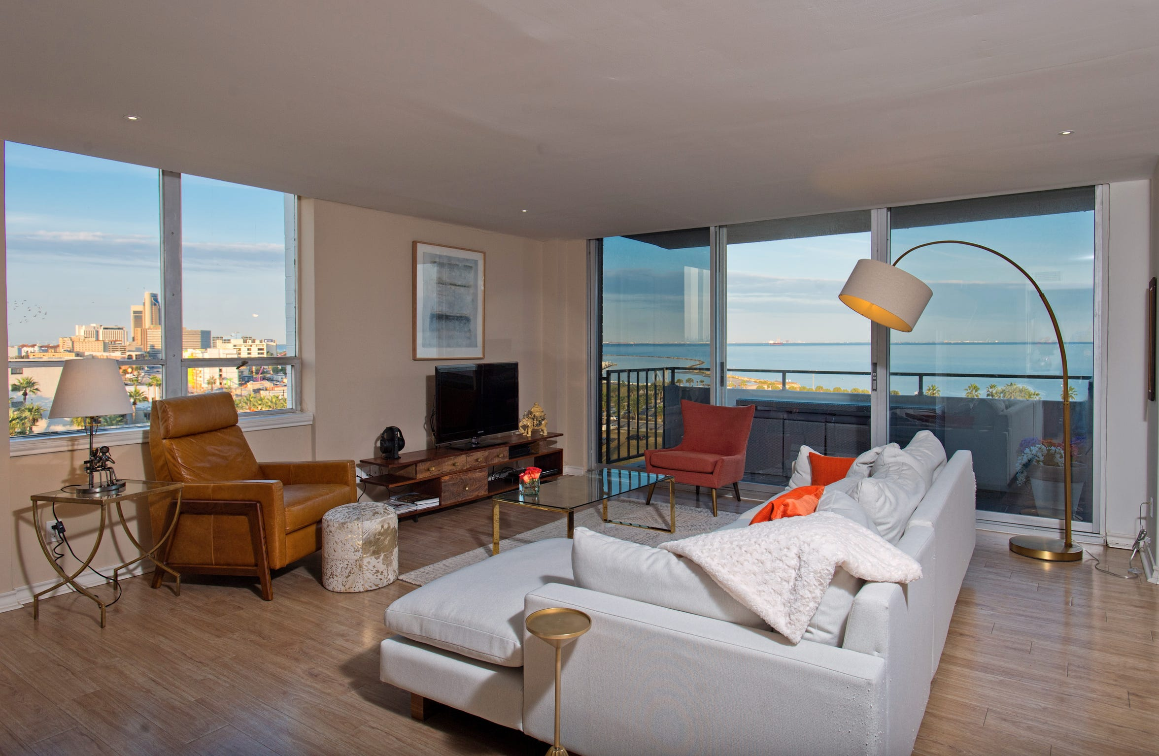 The corner living space of this 7th floor unit takes in panoramic views of Corpus Christi Bay, the parks, marina and downtown.