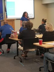 Ashley Mutch Mentorship and Training Manager for Pets For Life talking to a group during a presentation at the Corpus Christi Police Department.