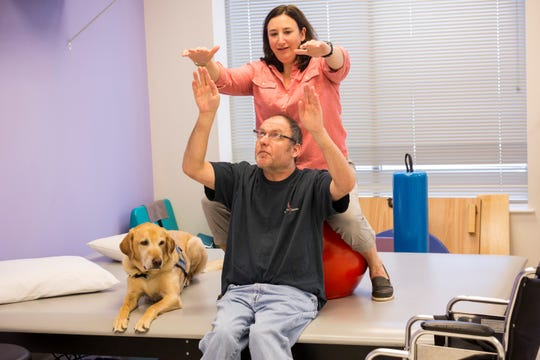 Carolyn Tassini, a physical therapist, works with a client at Bancroft Neurorehab.