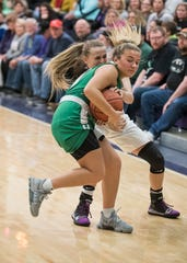 Unioto's Emily Coleman attempts to steal the ball from Huntington's Emily Haubeil during the second half of the game at Unioto High School Tuesday afternoon. Unioto defeated Huntington 45-33.