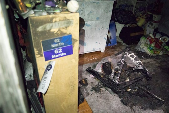 The travel playpen where Eva Ray slept at her grandparents lays charred inside the room where a fire cause by a humidifier set off the smoke alarm that allowed the family to escape the house and call for help.