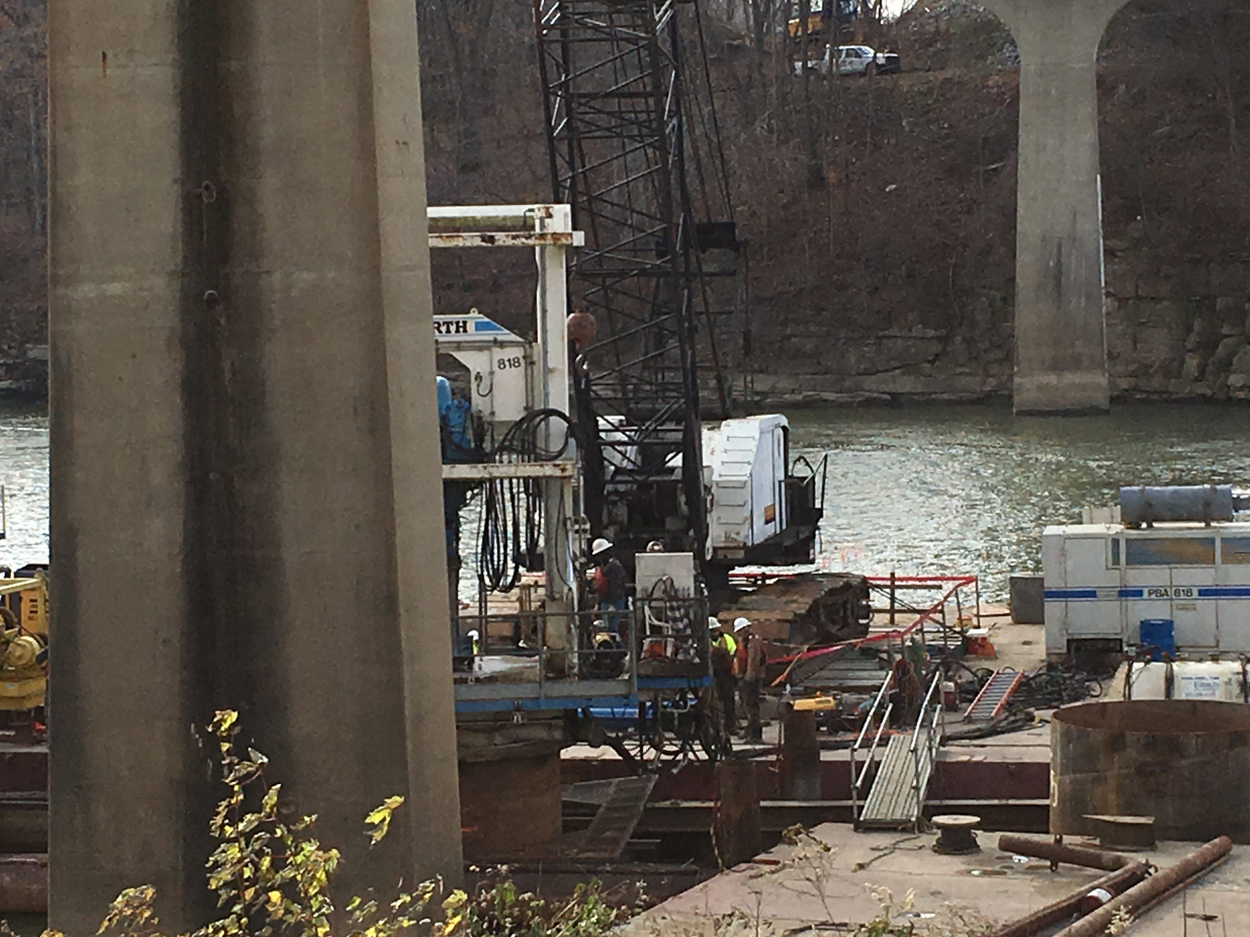 A drilling rig bores into rock below the Cumberland River to a support pier for the new McClure Bridge.