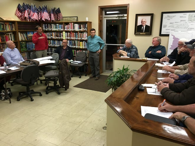 Kendrick Curtis, Assistant Director at Middle Tennessee Industrial Development Association, standing at left, explains a grant available from the state that would help bring a rail spur into the Stewart-Houston Industrial Park
