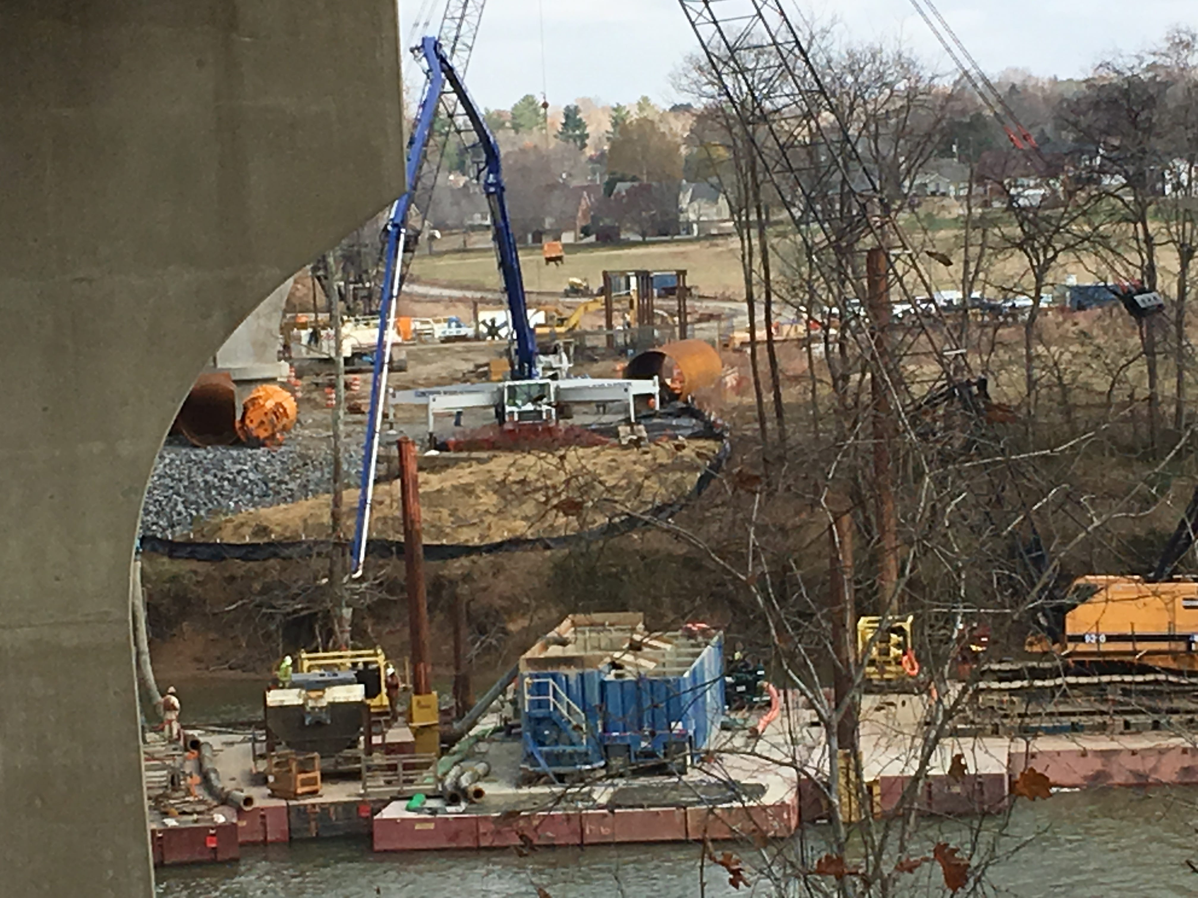 Concrete is being pumped into a drilled shaft that will support a pier beneath a new span of McClure Bridge.