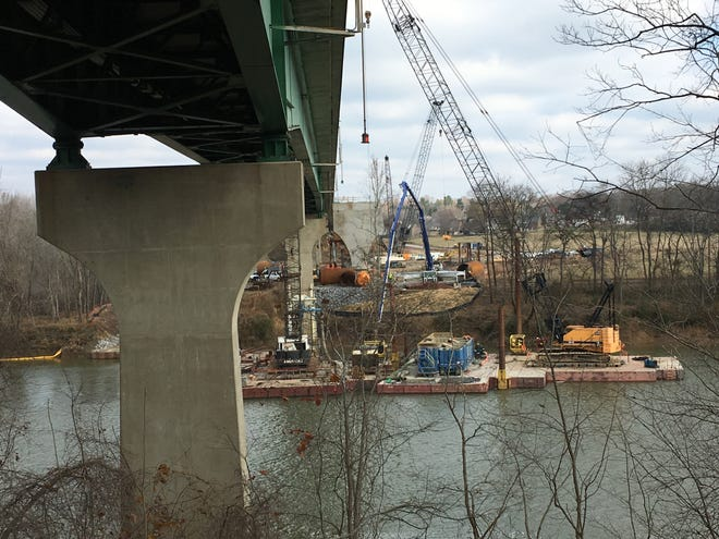 Construct crew work from barges in the Cumberland River to erect one of two support piers to be placed in the water.