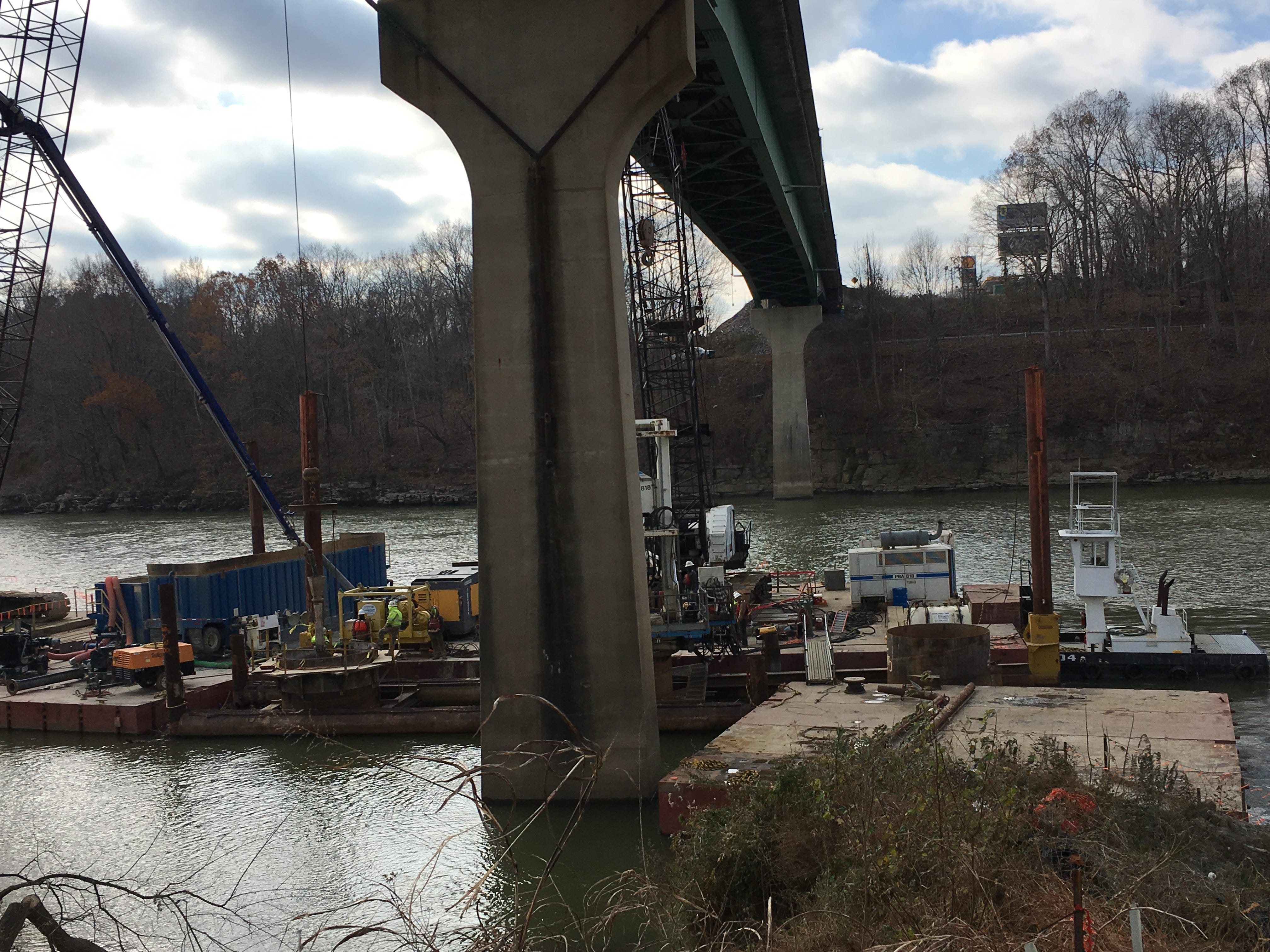 A shaft is filled with concrete at right, as another shaft is being drilled, center, in the Cumberland River.