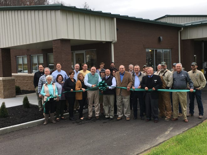 MLEC and local officials gather for a ribbon-cutting to officially open the electric co-op's new office in Houston County