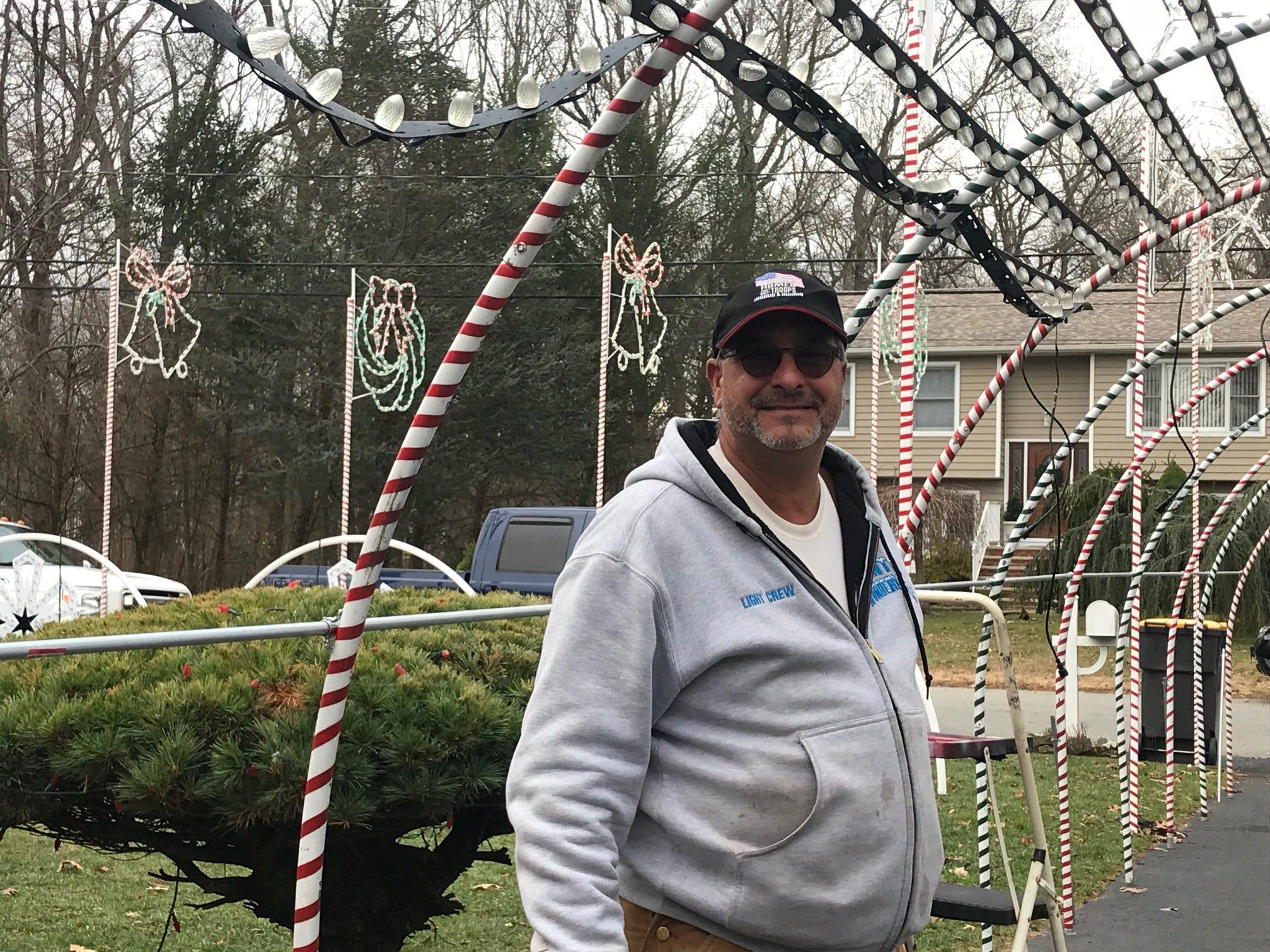 Thomas Apruzzi of Old Bridge readies his holiday lights show for the season.