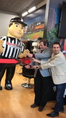 Sport Clips Haircuts opened its doors at the North Village Shopping Center in North Brunswick.