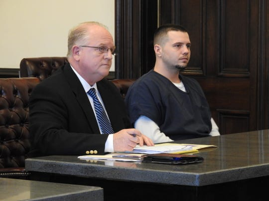 Attorney Jeffrey Mullen and his client Christopher Thompson in Coshocton County Common Pleas Court. Thompson received three years total in prison on three counts of trafficking in methamphetamine.