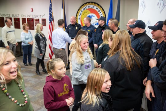 Mike Kennedy and his family meet with the first responders at the Urbandale Police department Thursday, Nov. 29, 2018. The first responders rescued him after he suffered a seizure and drove into a freezing pond Monday.