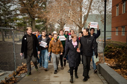 Grinnell students follow Dean Michael Latham and Chief of Staff Angela Voos as they protest the schools attempt to to quash the unionization by appealing a recent expantion vote to a Republican-majority National Labor Relations Board Friday, Nov. 30, 2018.