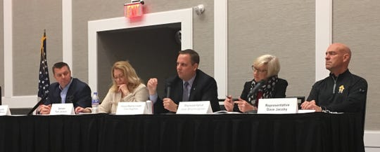Iowa House Majority Leader Chris Hagenow, R-Urbandale, center, speaks at a meeting of the Iowa Taxpayers Association on Friday, Nov. 30, 2018, at Prairie Meadows in Altoona. Other panelists, from left, are Senate Majority Leader Jack Whitver, R-Ankeny;  Sen. Pam Jochum, D-Dubuque; Hagenow; Rep. Jane Bloomingdale, R-Northwood; and Rep. Dave Jacoby, D-Coralville.
