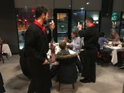 Gauchos deliver sizzling hot meats to the tables at BAH Brazilian Steakhouse.