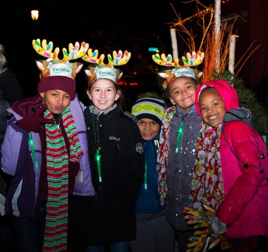 Gbomi Kayode, 10, Claire Norton, 10, Onami Kayode, 6, Jumi Kayode, 8, and Shionna Moody, 8, all of Des Moines eagerly wait for the horse and trolley ride on Thursday, Nov. 29, 2018 at Jingle in the Junction in  Historic Valley Junction in West Des Moines.