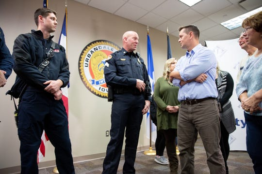 Urbandale Police Sgt. Mark Jorgensen chats with Mike Kennedy and his family at the Urbandale Police department Thursday, Nov. 29, 2018. Andrew Klenk, left, is one of the Urbandale firefighters who helped rescue Kennedy.