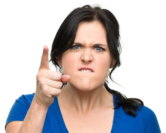Angry Young Woman Shakes Finger