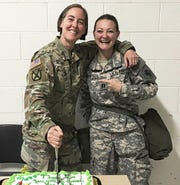 Major Dawn Opland, left, poses with Captain Shelly Rood before heading off to Japan, taken at the 645th RSG HQ, Southfield, June 2018.