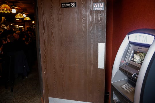 An ATM machine at the front entrance of the Miller's Bar in Dearborn, Tuesday, Nov. 27, 2018.
