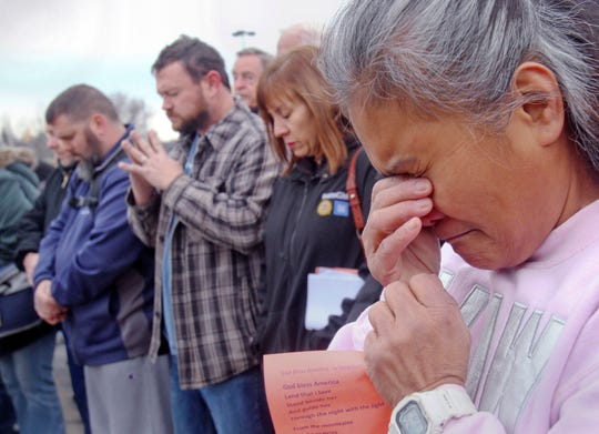 Venus Walker, of Warren, Ohio and a GM employee with 12 years at the Lordstown plant, prays during a vigil outside the Lordstown GM plant November 29, 2018. About 200 workers attended the event. GM recently announced production of the Chevrolet Cruze would stop in March of 2019 leaving more than 1,500 without a job.
