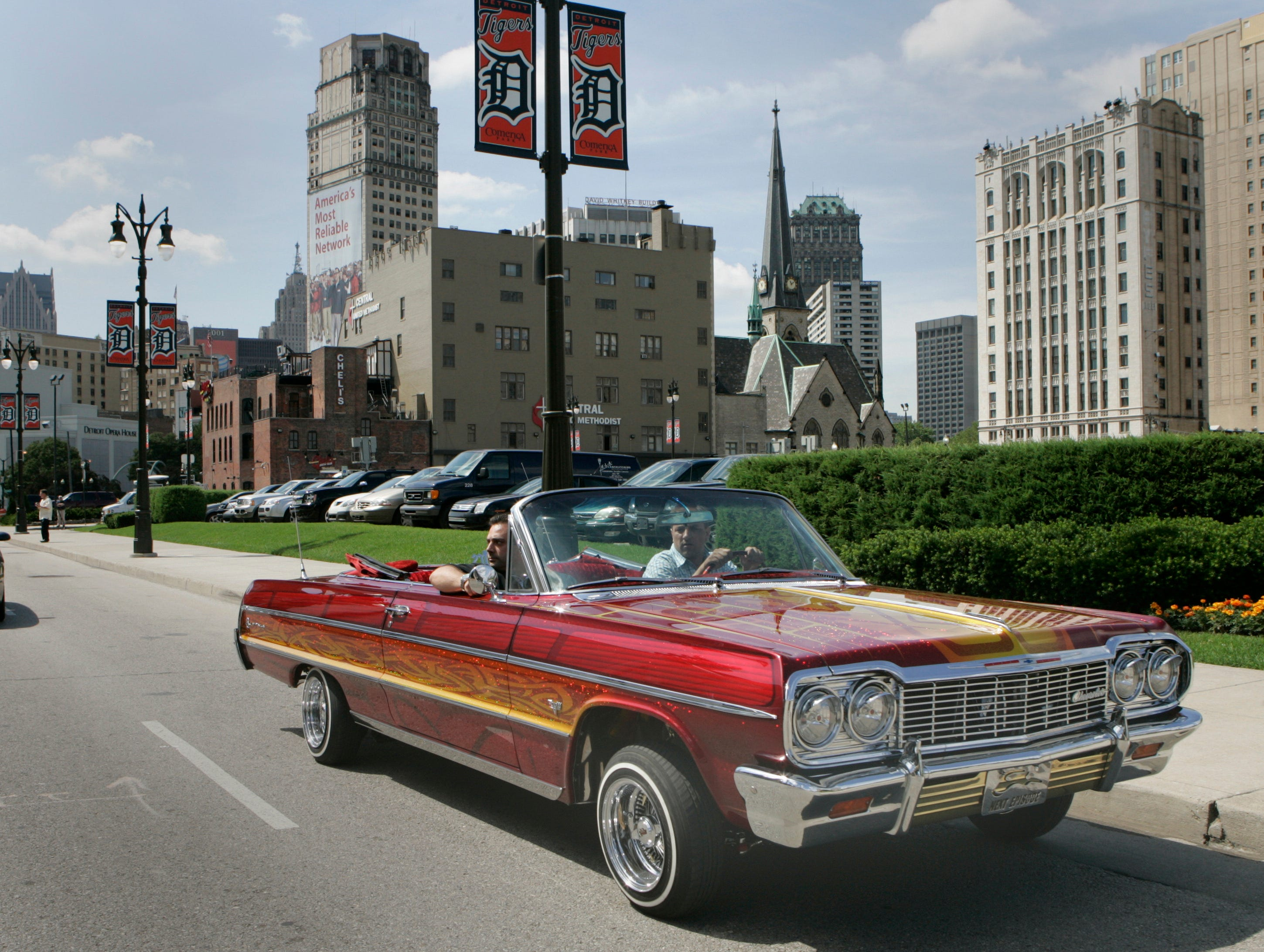 A 1964 Chevy Impala owned by Thomas Cavataio drives down Woodward in Detroit, June 24, 2008.