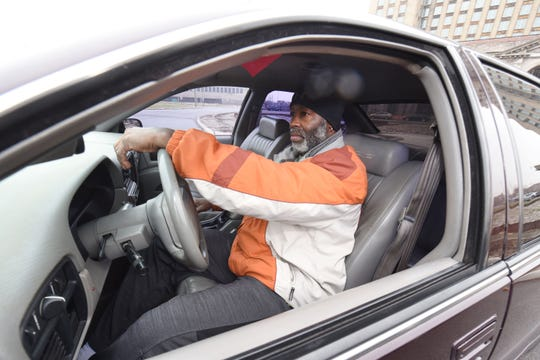Derrick Jones of Roseville sits behind the wheel of his 1996 Chevy Impala.