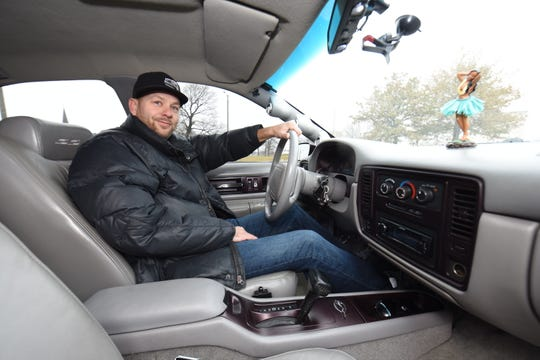 Dan Gersch of St Clair Shores sits behind the wheel of his 1996 Chevy Impala.