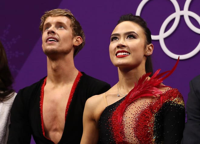 Novi's Madison Chock, right, and Northville's Evan Bates wait for their marks after the ice dance short program at the PyeongChang 2018 Winter Olympic Games.