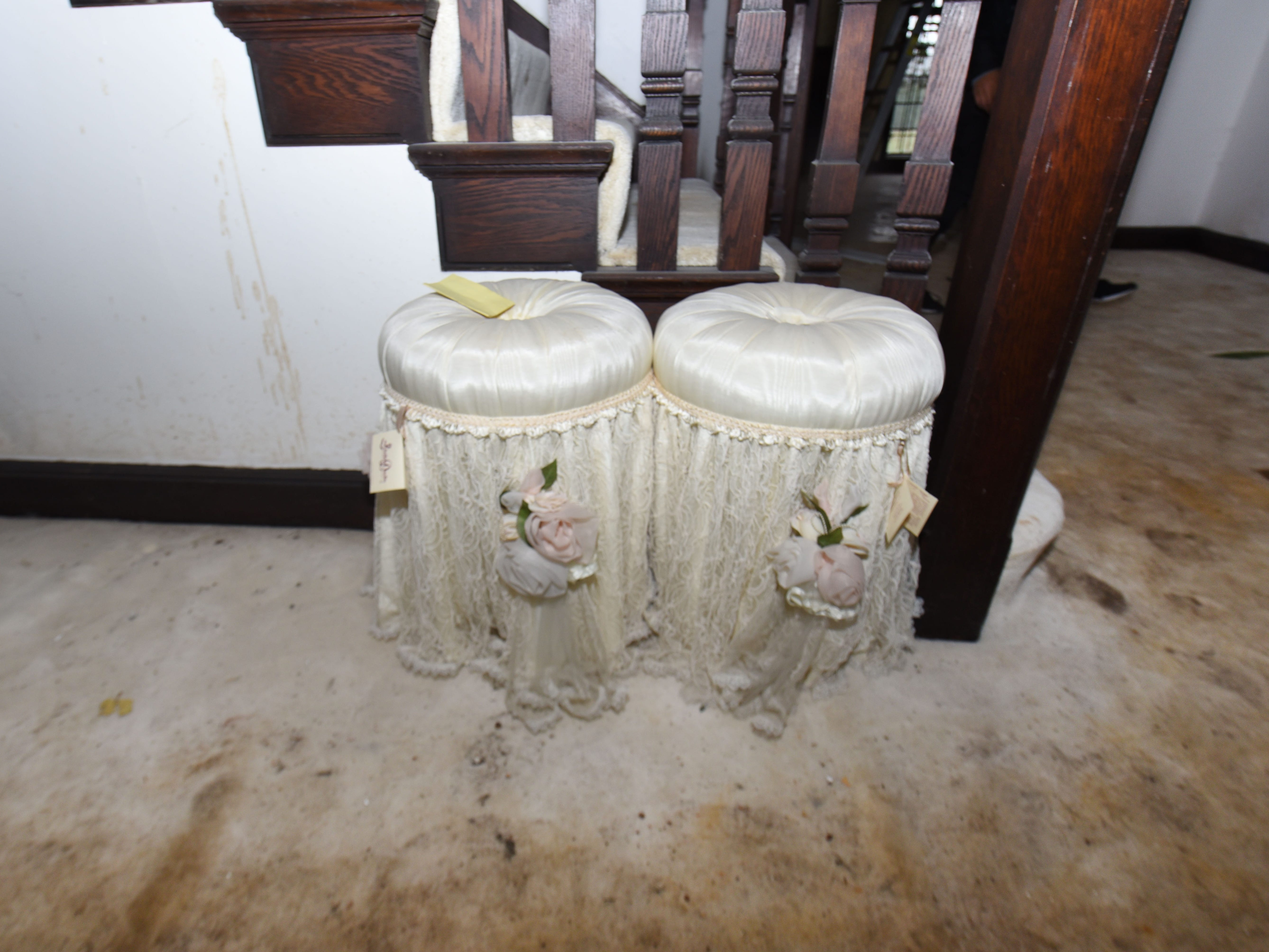 A pair of tufted seats, still bearing their sales tags, sit in the main hall.
