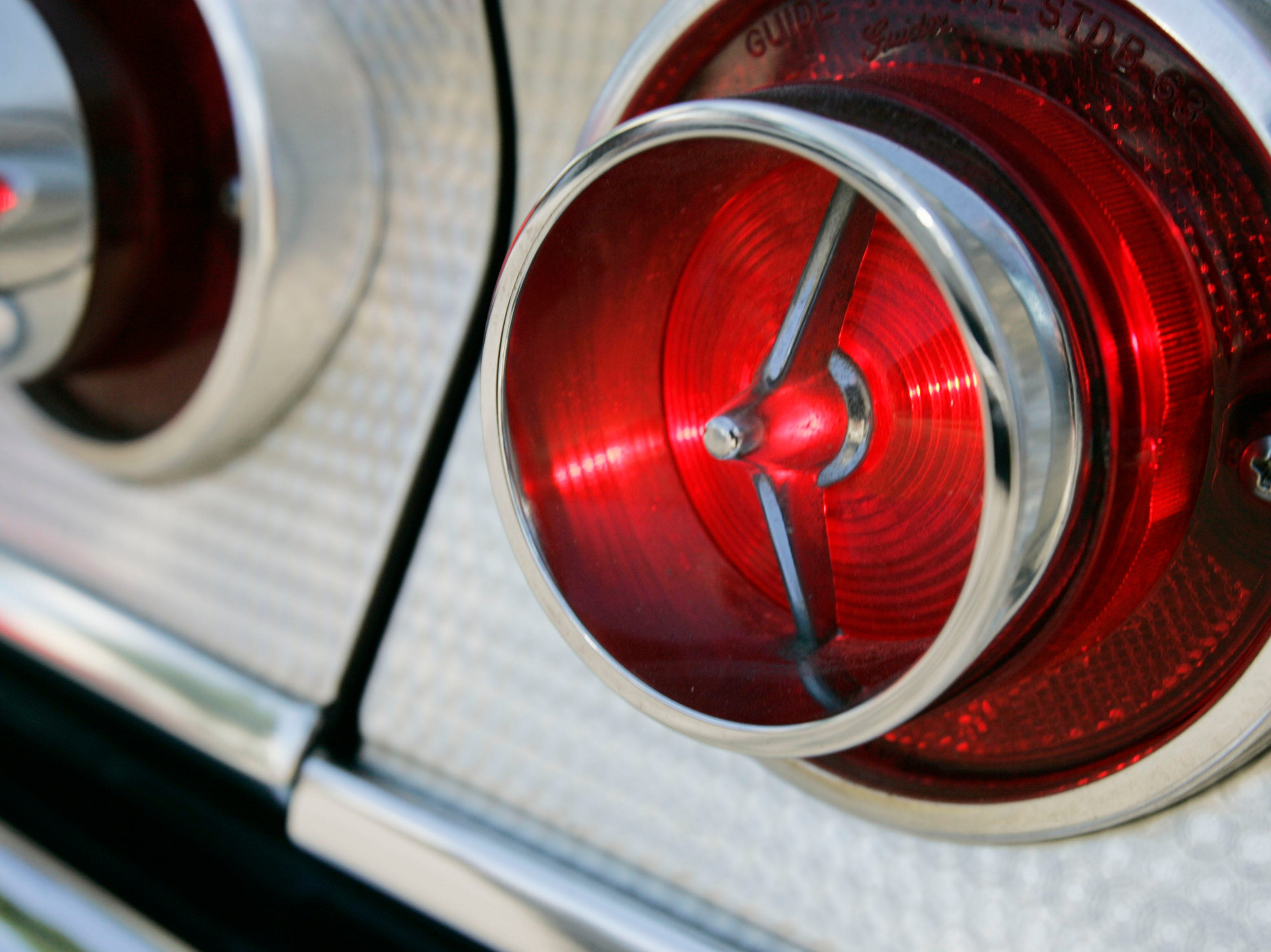 The tail light of a 1963 Impala SS cruising down Woodward during the Dream Cruise, Aug. 16, 2008.