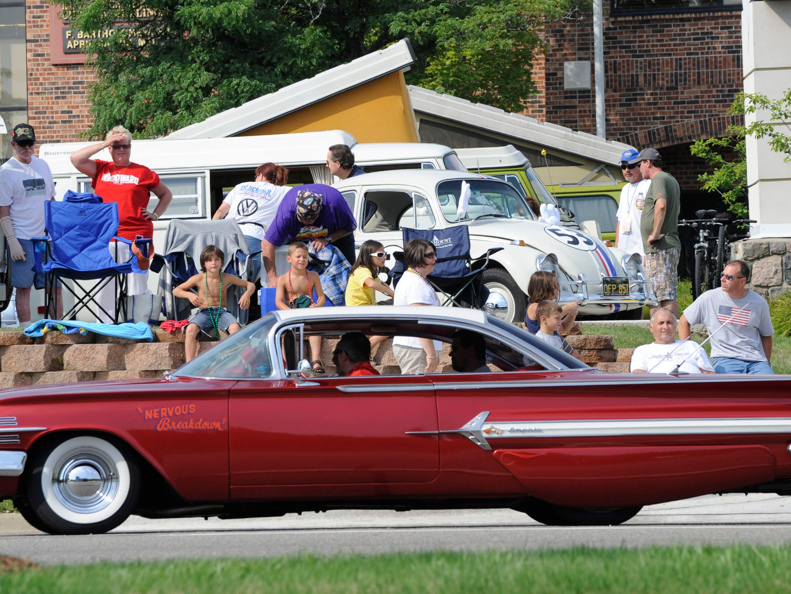 This 1960 Chevrolet Impala Super Sports makes its way down Woodward in Bloomfield Hills.