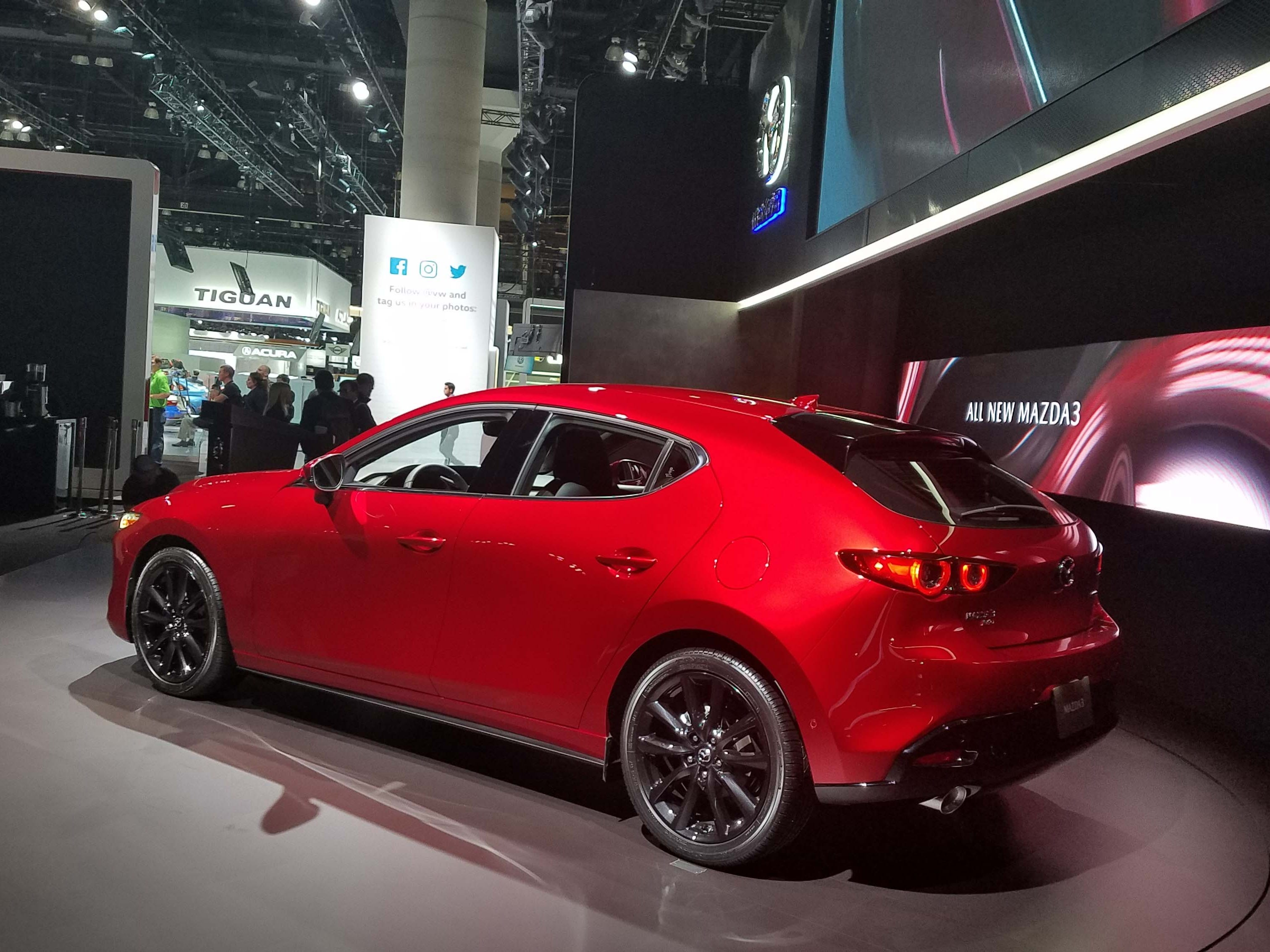 The Mazda 3 sports sexy looks and a Soul Red paint job. Not bad for a $25k compact hatch.
