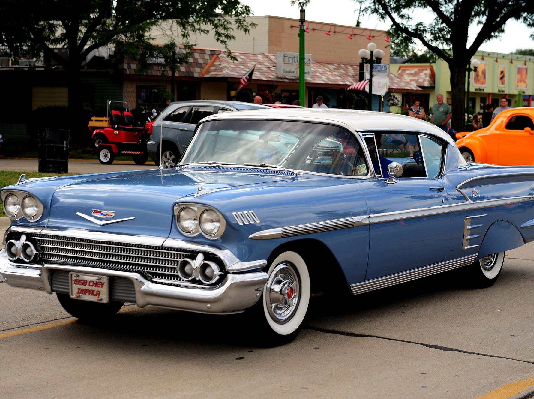 A 1958 Chevy Impala cruises down Woodward in Clawson on Aug. 10, 2013.