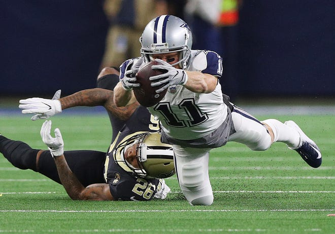 Cole Beasley of the Dallas Cowboys stretches for a first down against P.J. Williams of the New Orleans Saints in the fourth quarter.