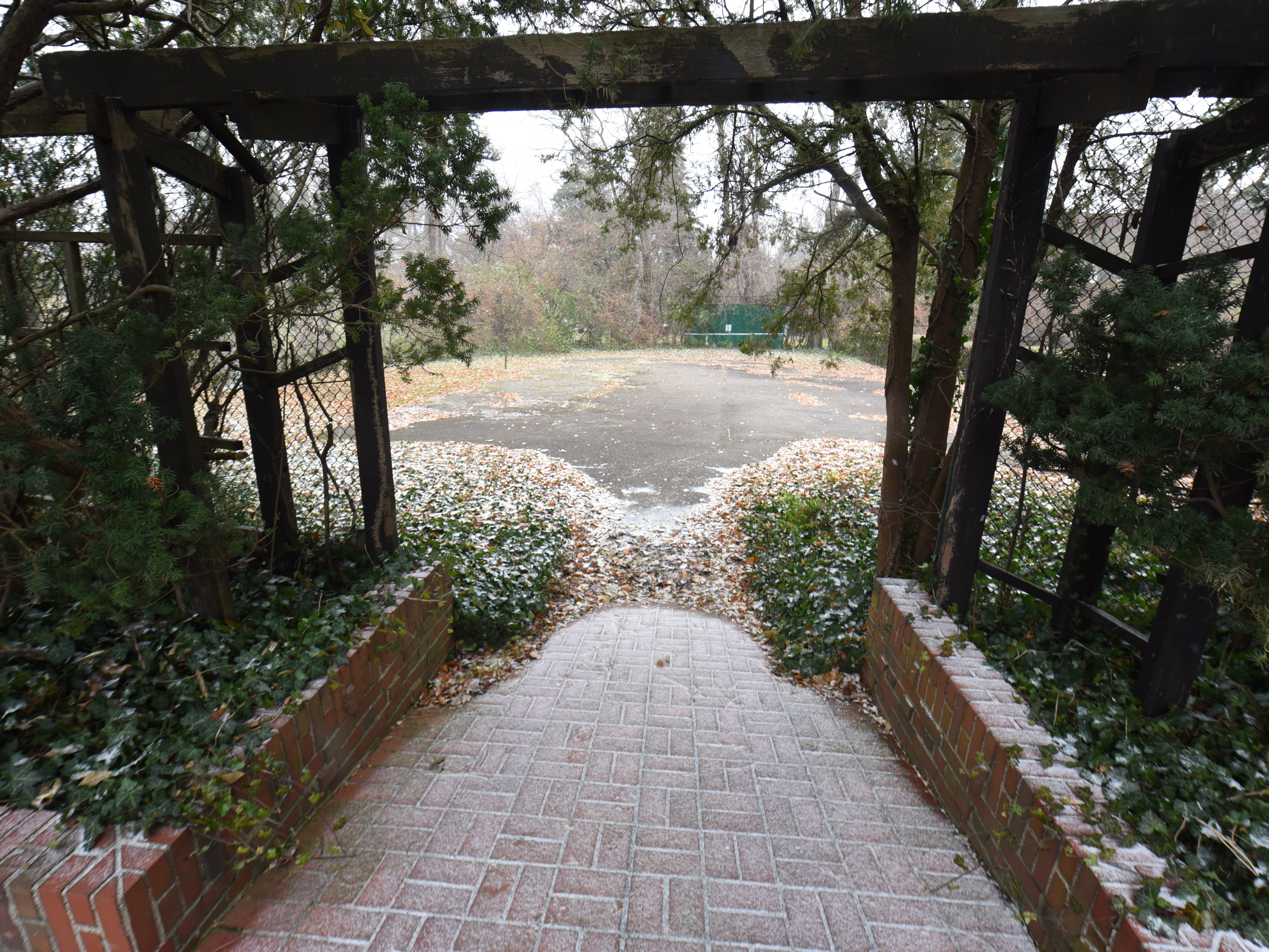 A walkway in the back leads to an area that was used for entertaining.