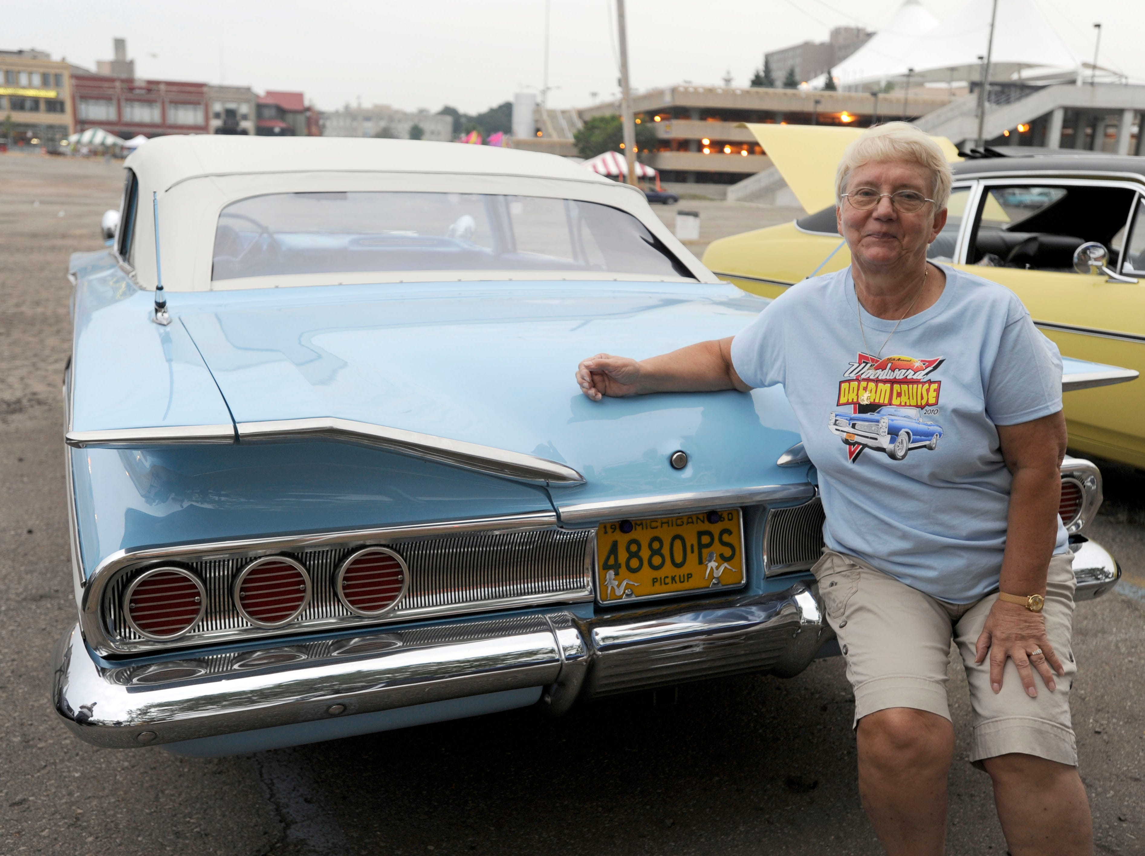 Gay Pousho of White Lake poses with her 1960 Chevrolet Impala Convertiblle in downtown Pontiac.