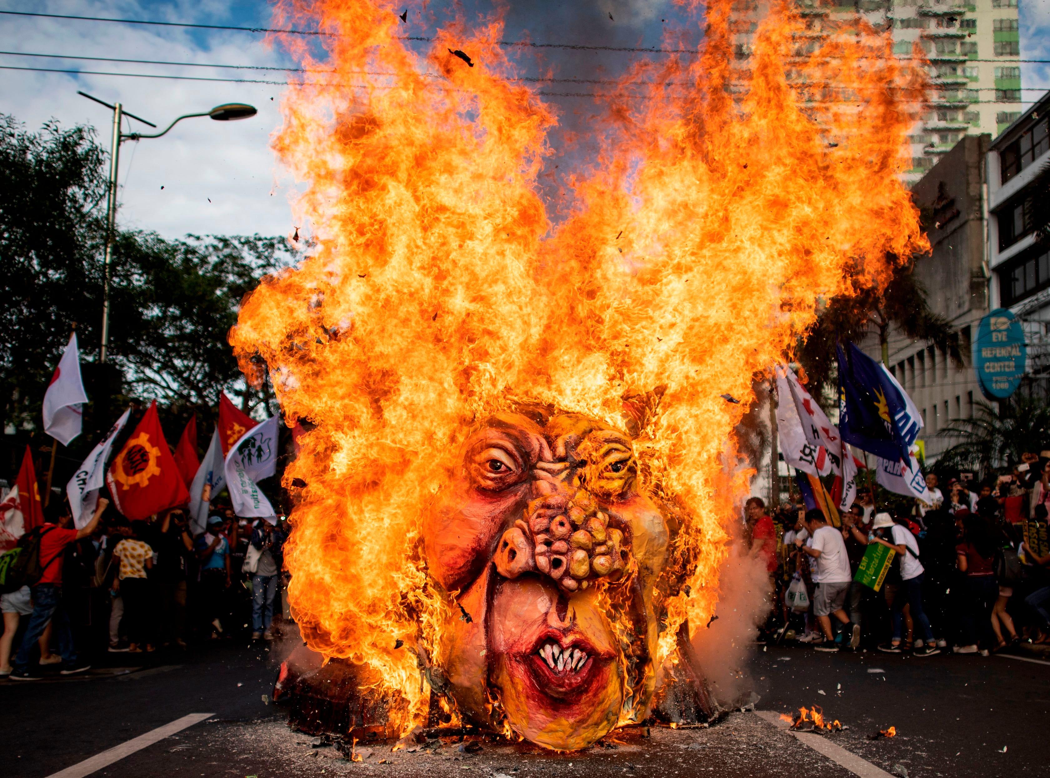 Activists burn an effigy of Philippine President Rodrigo Duterte near the US Embassy in Manila on November 30, 2018, during the commemoration of the 155th birthday of working-class hero Andres Bonifacio.