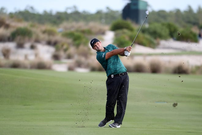 Patrick Reed hits his second shot into the 18th green during round one of the Hero World Challenge at Albany, Bahamas.
