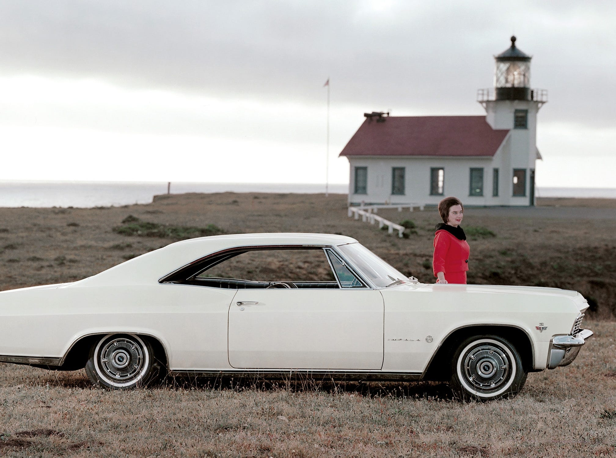 A 1965 Chevrolet Impala Sport Coupe