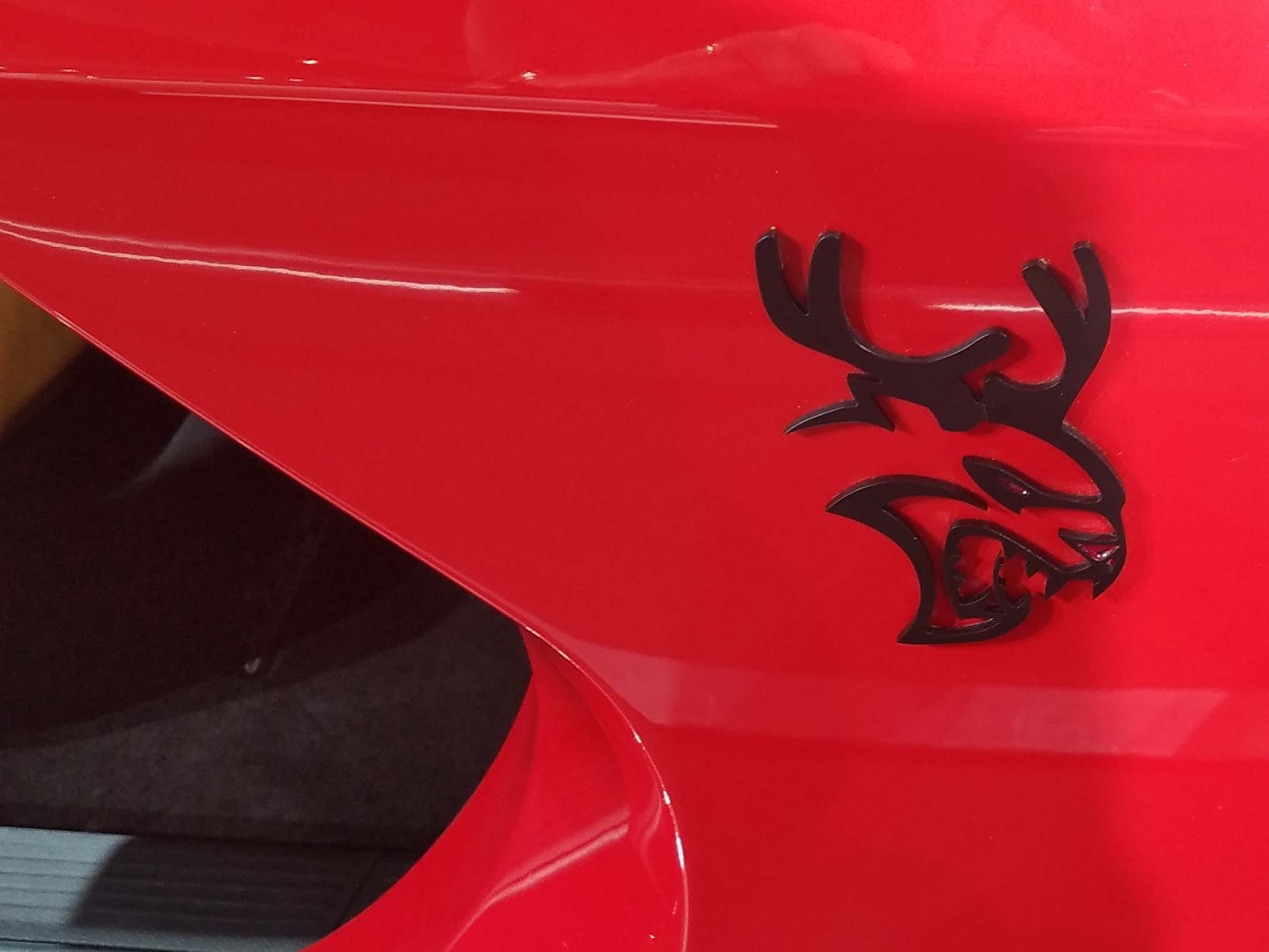 The Dodge Challenger Hellcat Redeye sleigh sports a Hellcat logo. . . with reindeer antlers.