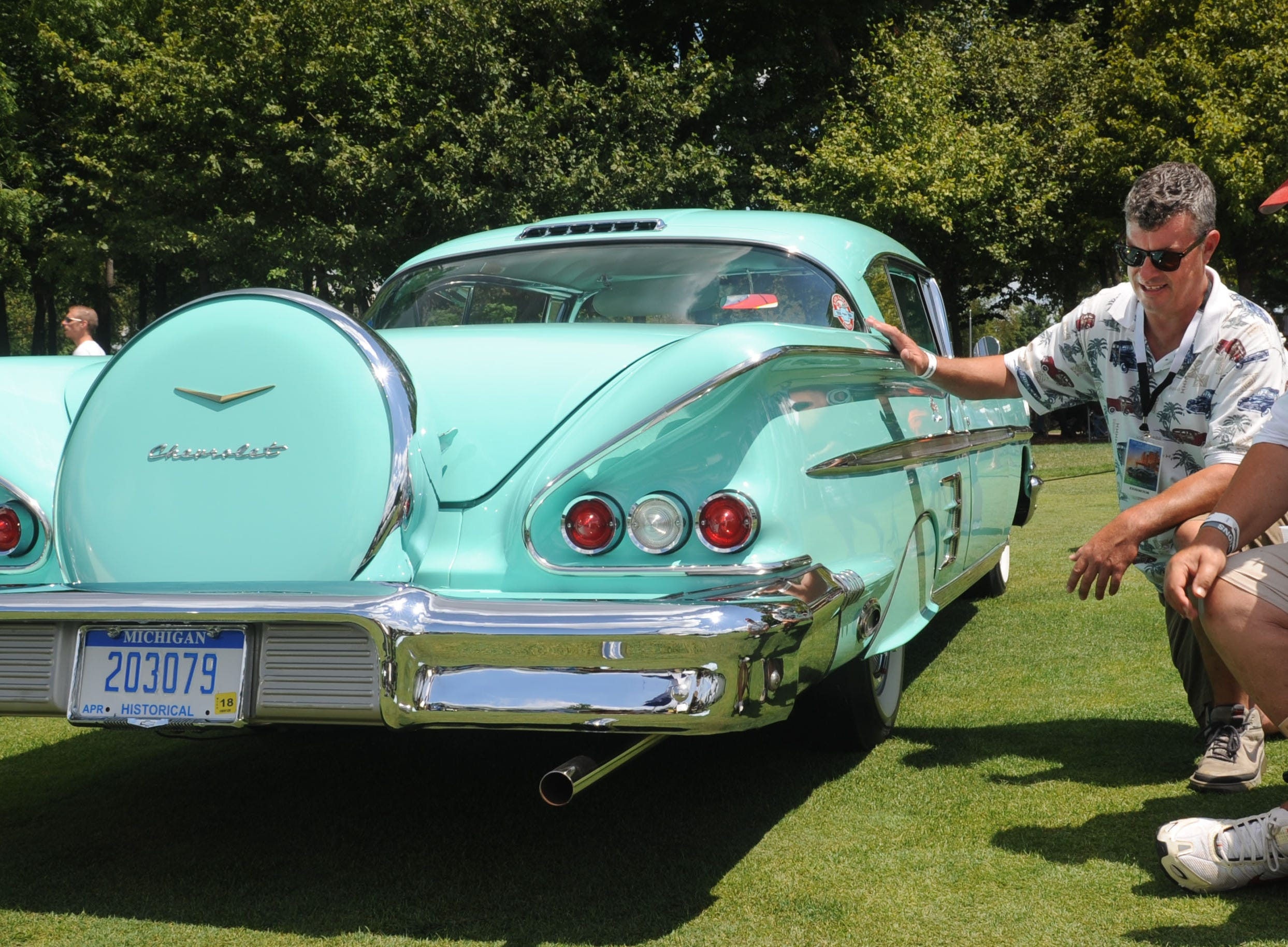 Kurt Machacek and his father Bob Machacek, of Farmington Hills, with their 1958 Chevrolet Impala during the Concours d'Elegance at St. John's in Plymouth.
