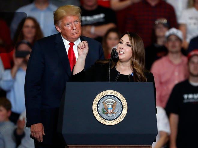 President Donald Trump listens as Chair of the Republican National Committee, Ronna McDaniel, right, speaks during a campaign rally in November in Cape Girardeau, Mo.