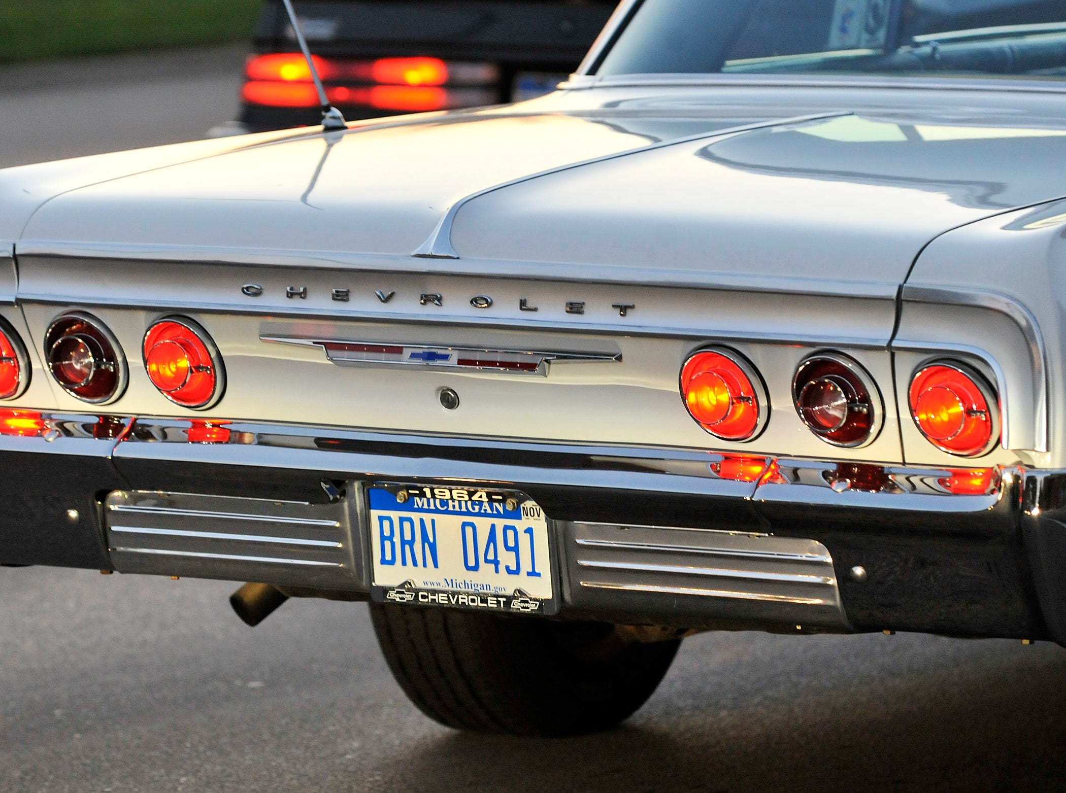 The taillights of a 1964 Chevrolet Impala on Woodward during the Dream Cruise, Aug. 14, 2009.