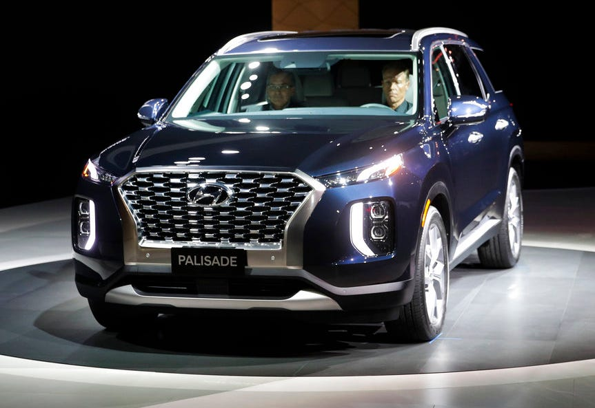 Brian Smith, left, Hyundai Motor America's COO, sits in the 2020 Hyundai Palisade to introduced the SUV at the Los Angeles Auto Show Wednesday, Nov. 28, 2018, in Los Angeles.